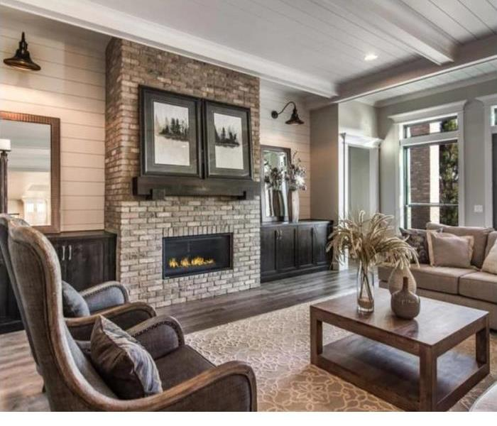Living room with in wall brick fireplace showcasing proper fireplace safety